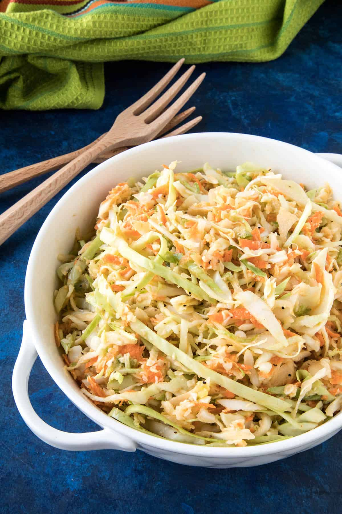 This Spicy Creamy Coleslaw is made with shredded cabbage, carrots, onion and jalapeno, then tossed with a creamy, spicy dressing