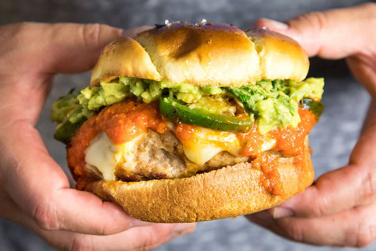 This Guacamole Turkey Burger is Loaded with Roasted Jalapeno Peppers, Creamy Guacamole, and Spicy Hot Sauce