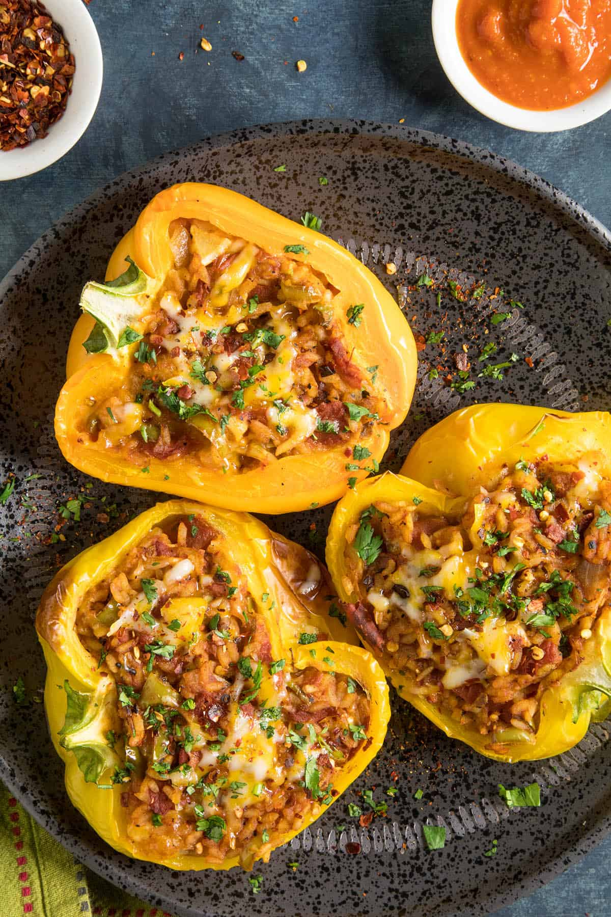 These Vegetarian Stuffed Peppers are stuffed with loads of spicy rice, cheese and more.