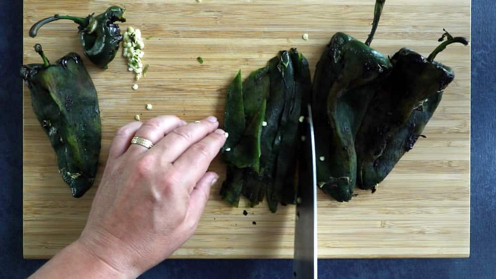 """Slicing the roasted poblano peppers into strips, or """"rajas"""""""