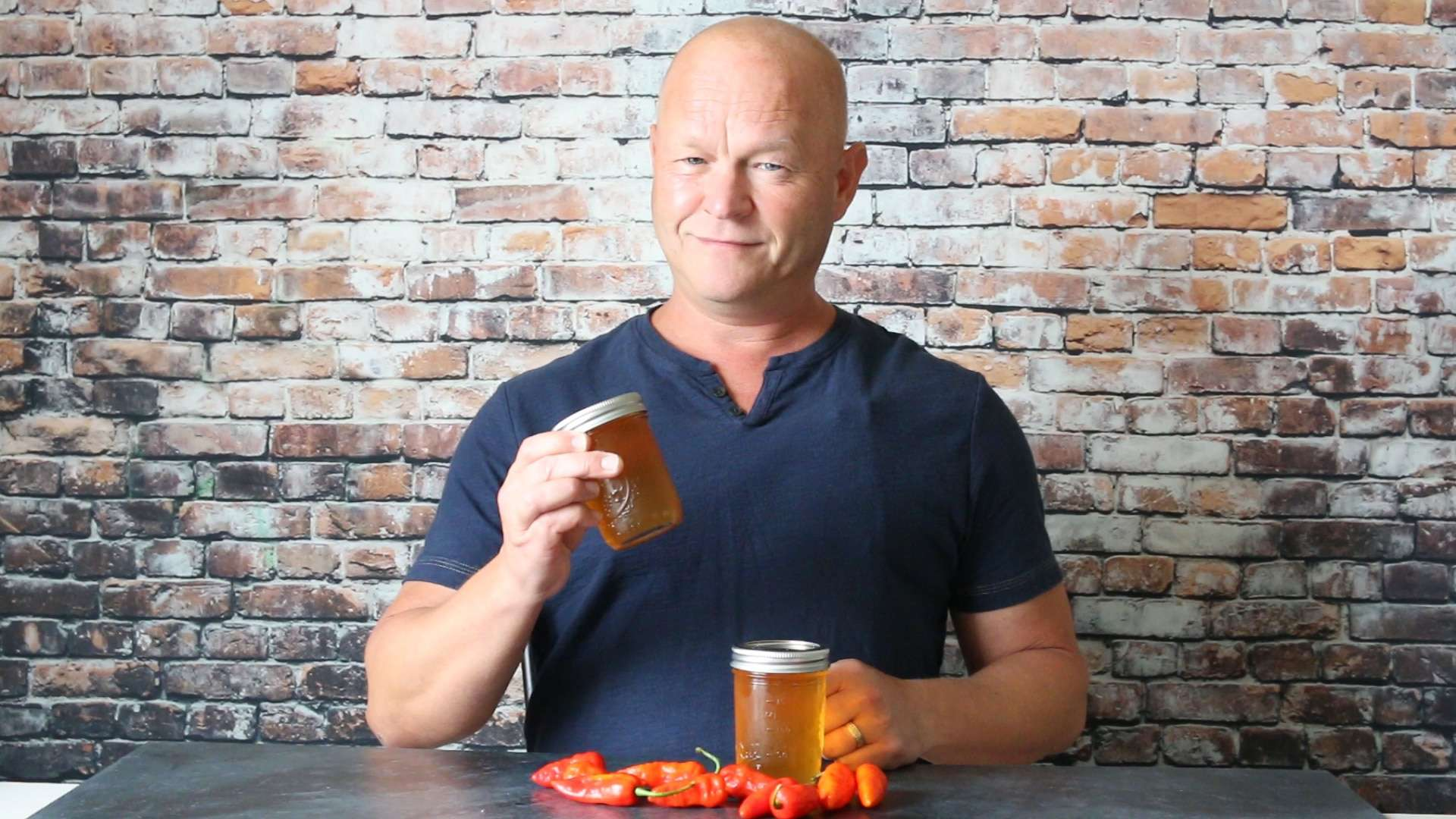 Mike holding his newly made ghost pepper jelly