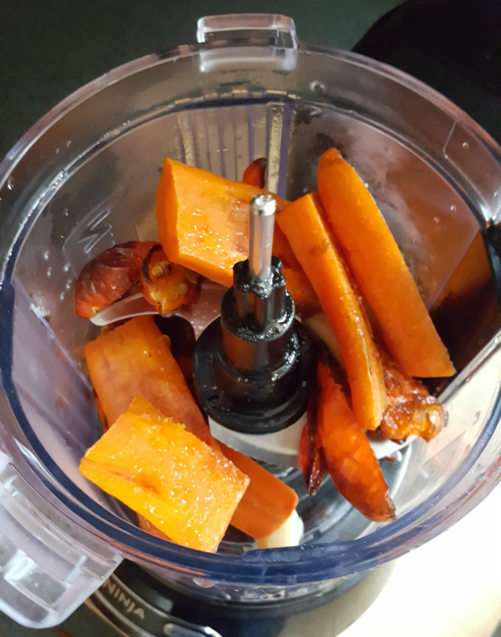 Roasted carrots, garlic and ghost peppers, ready to make sauce