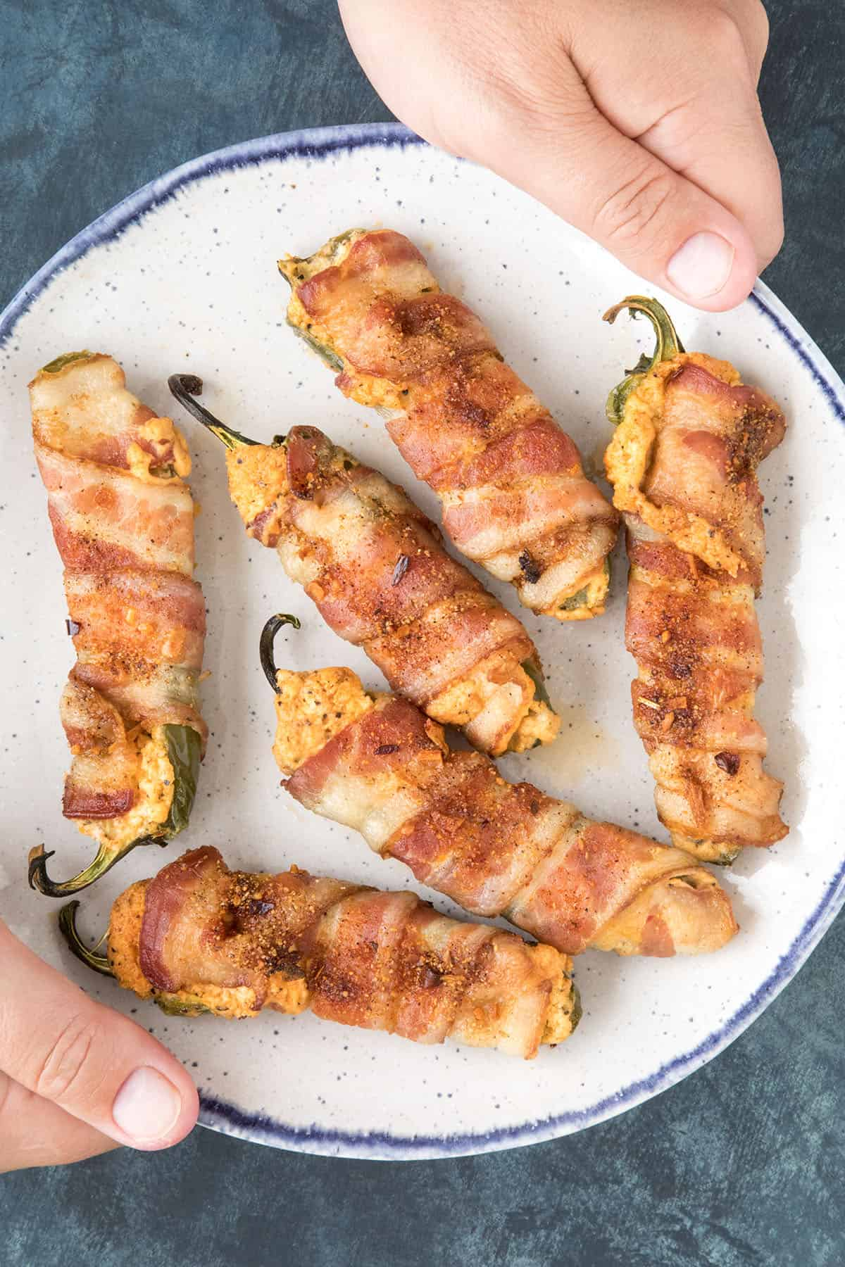 Bacon Wrapped Jalapeno Poppers - On a plate, ready to serve