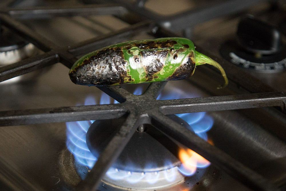 Roasting a jalapeno pepper over open flame