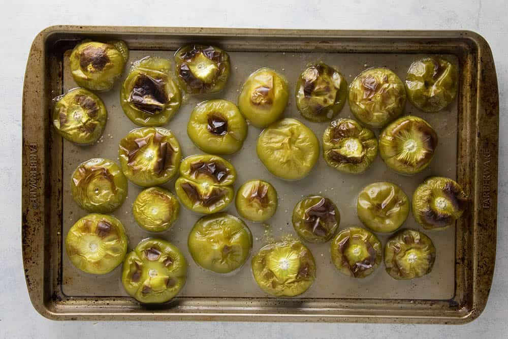 Roasted tomatillos on a pan
