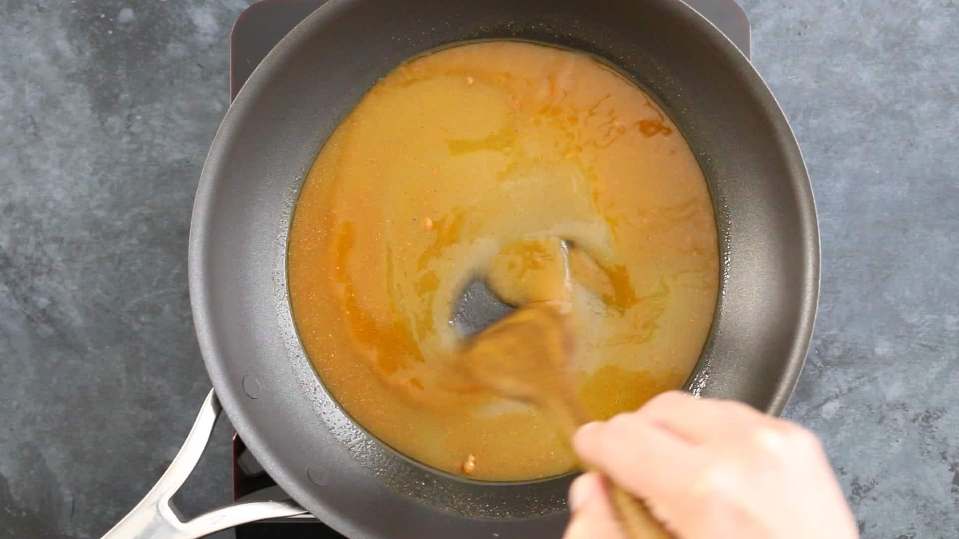 Stirring the seasoned simple sugar in a pan