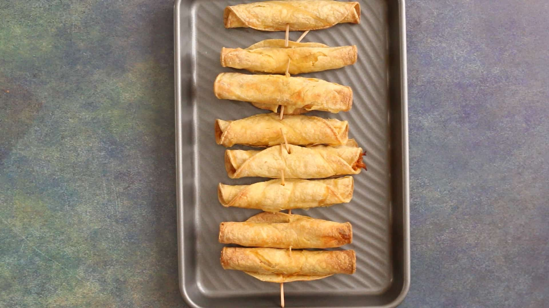 Baked Chicken Taquitos on a baking sheet
