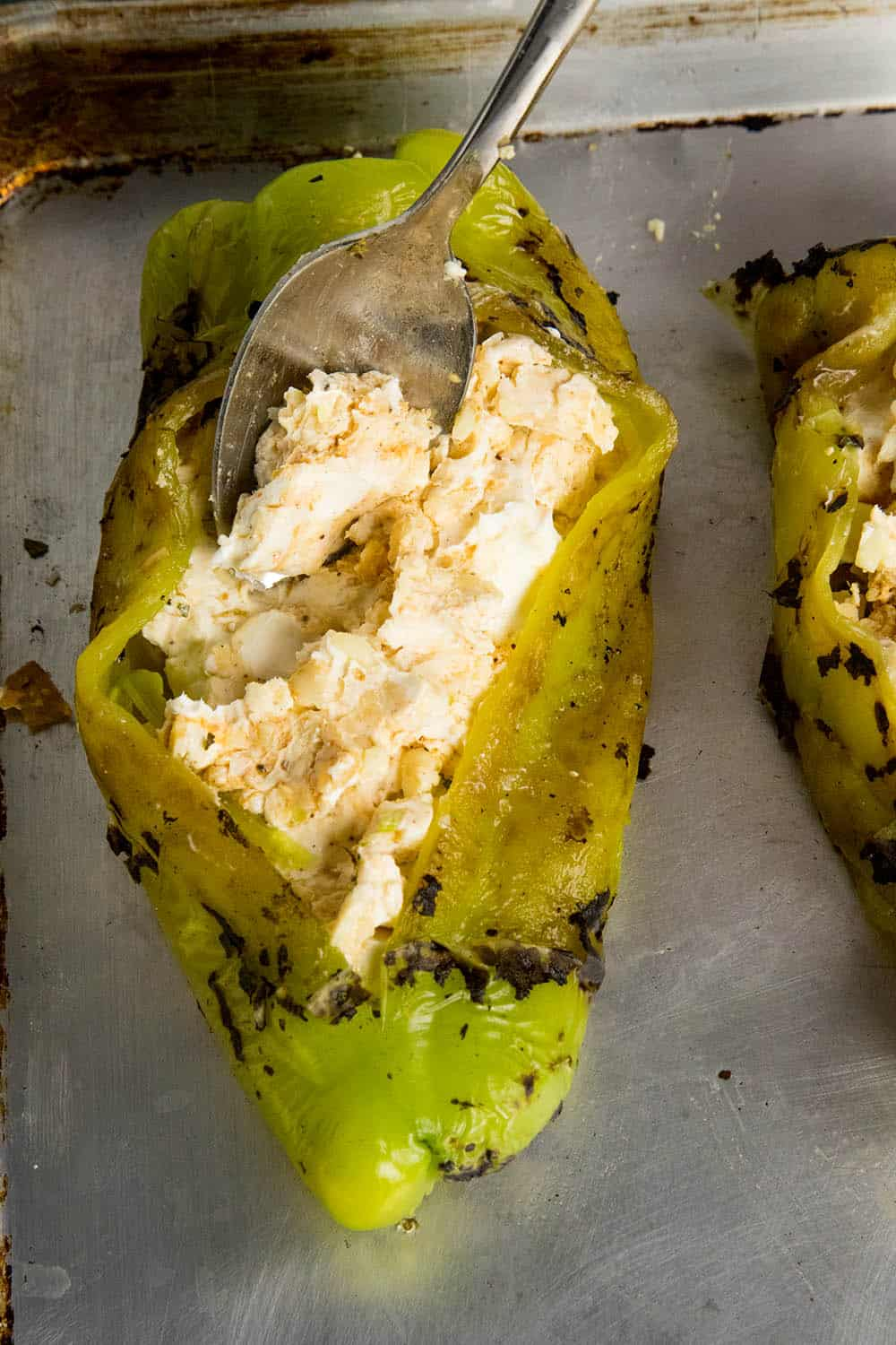 Stuffing the Anaheim peppers with Cajun cream cheese before baking