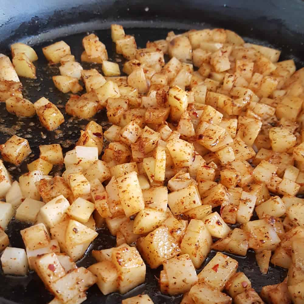 Add the seasoning to the cooking potatoes