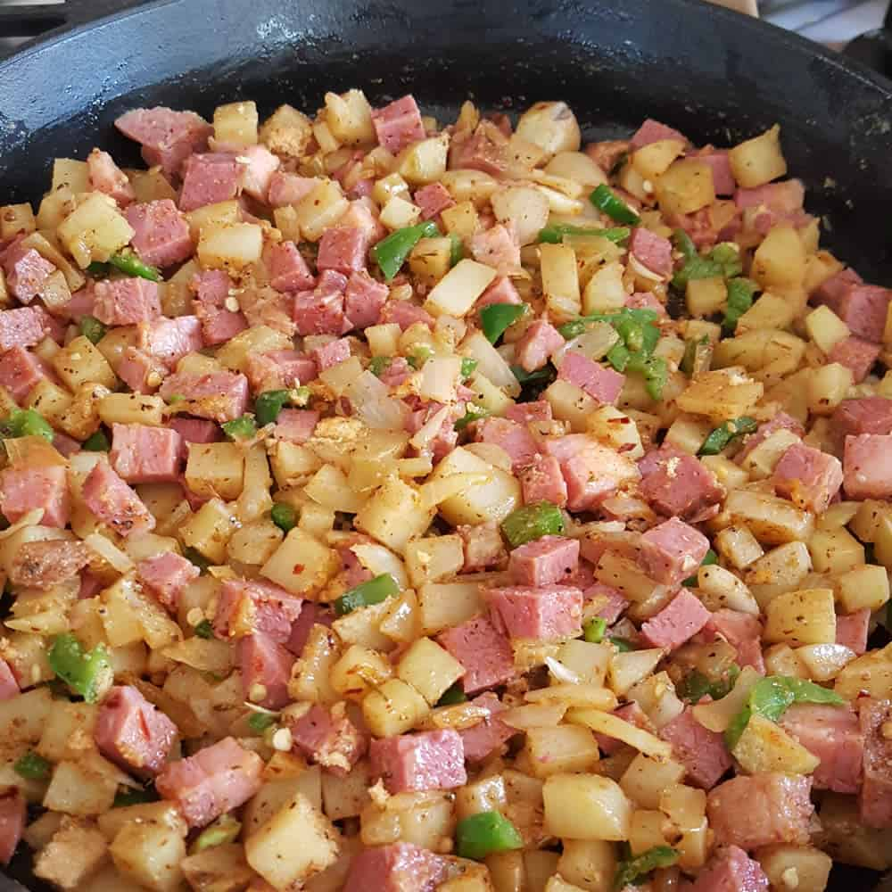 Add the corned beef to the cooking potatoes
