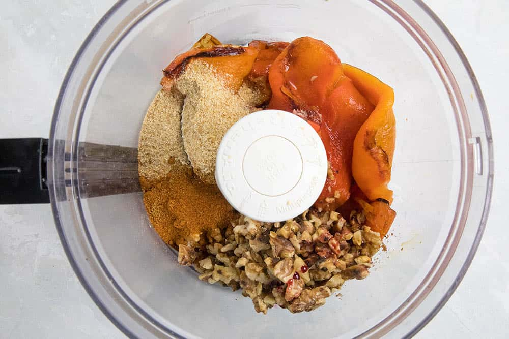 Ingredients in a food processor for our Muhammara Spread