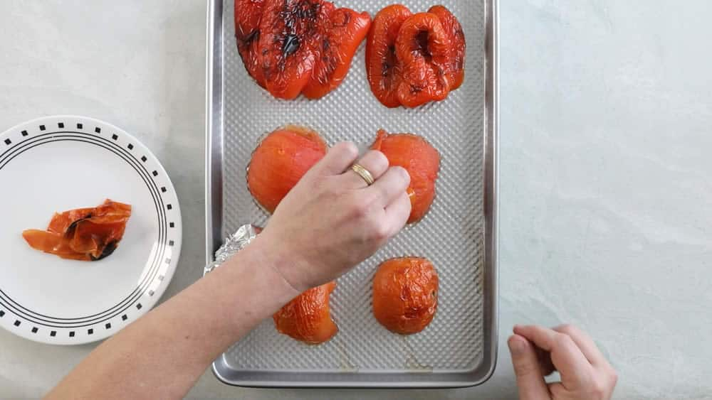 Peeling roasted tomatoes and peppers