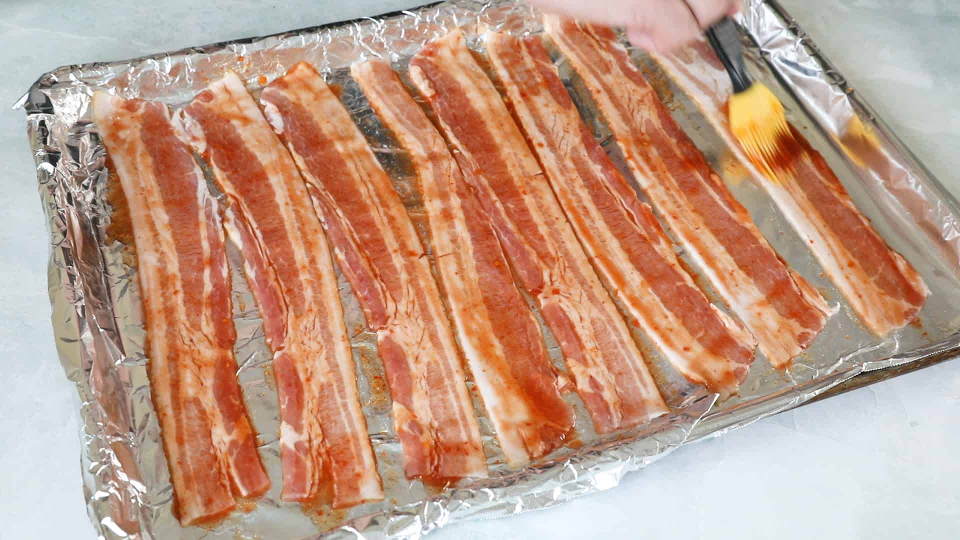 Rub down the bacon with your spicy ghost pepper mixture