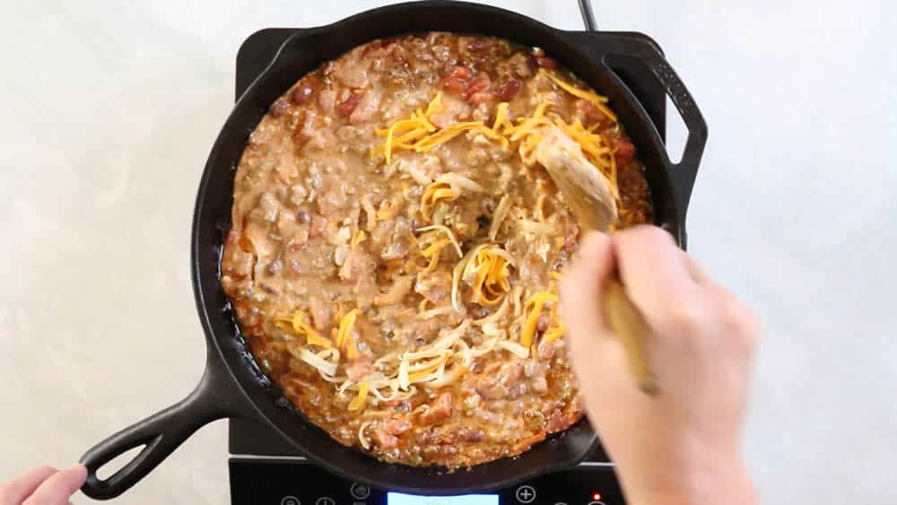 Stirring cheese into the chili cheese dip