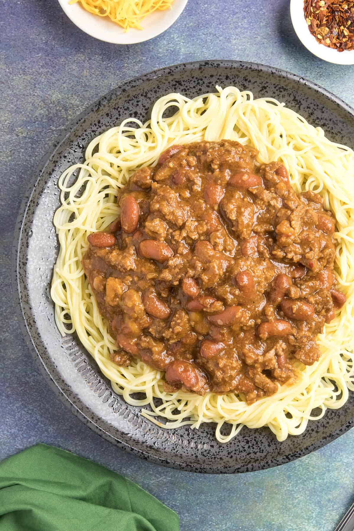 Cincinnati Chili on a plate of noodles, ready to eat