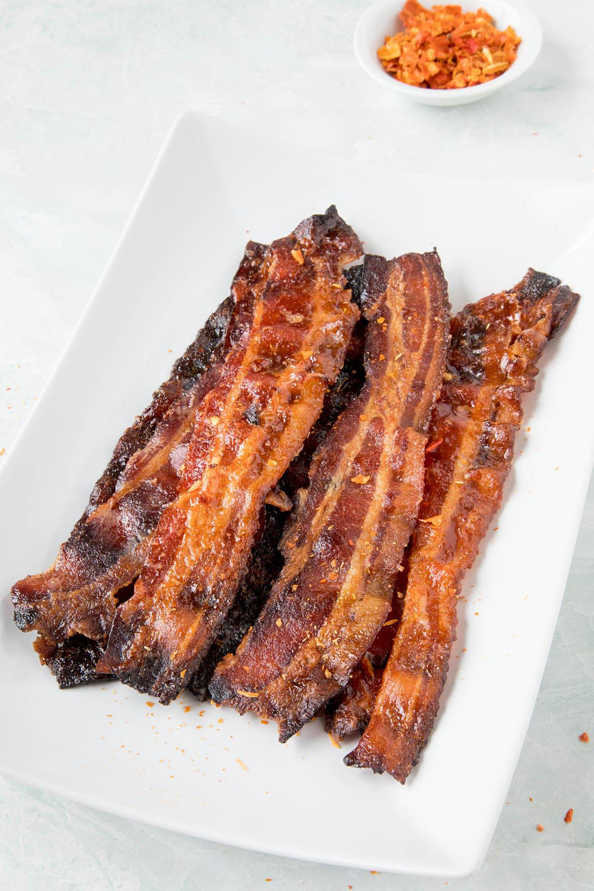 Ghost Pepper Candied Bacon - Stacked on a plate