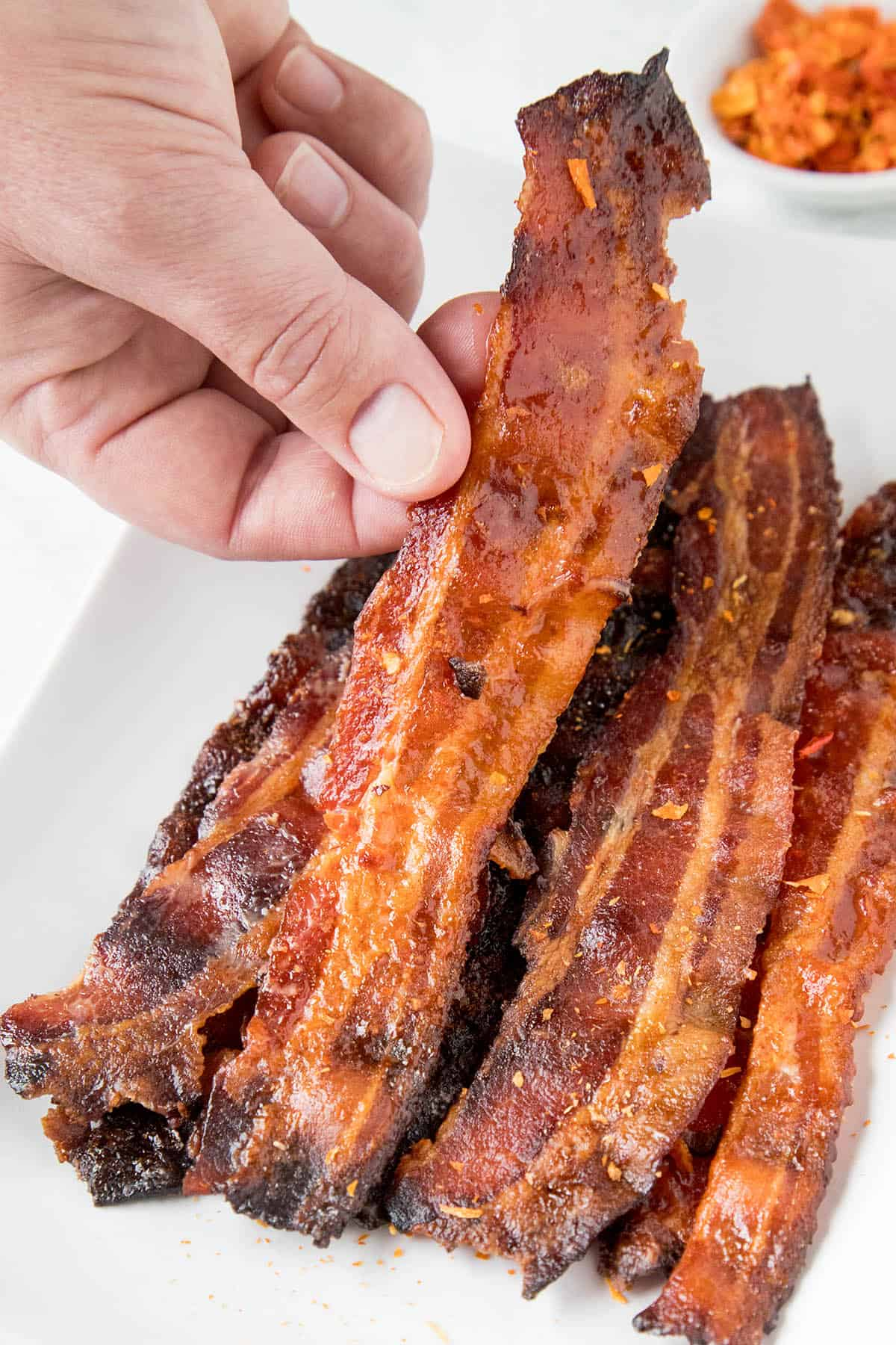 Grabbing a piece of Ghost Pepper Candied Bacon