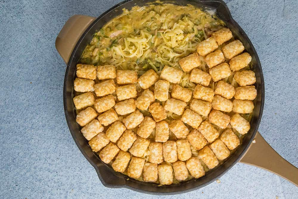 Cajun Ham and Turkey Tater Tot Casserole, in a pan, just before baking