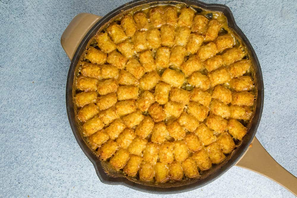Cajun Ham and Turkey Tater Tot Casserole, in a pan, ready to serve