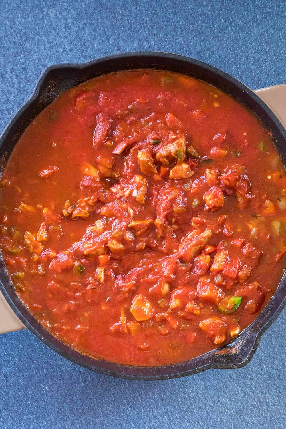 Simmering the Chicken Creole in a pan