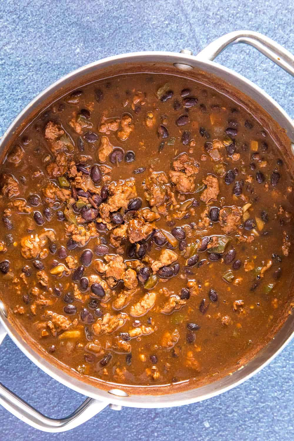 Black bean chili simmering in a pot