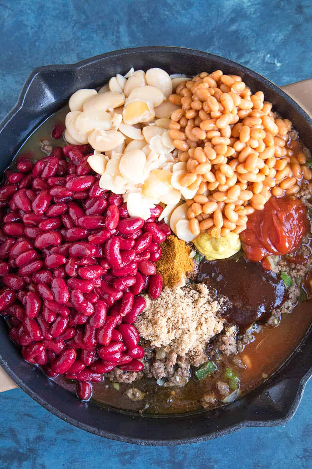 Adding the beans to the pan