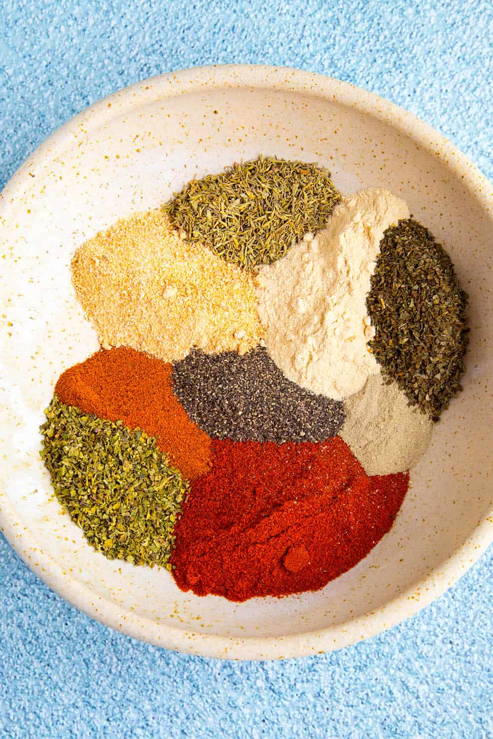 Homemade Creole Seasoning in a bowl, ready to be mixed