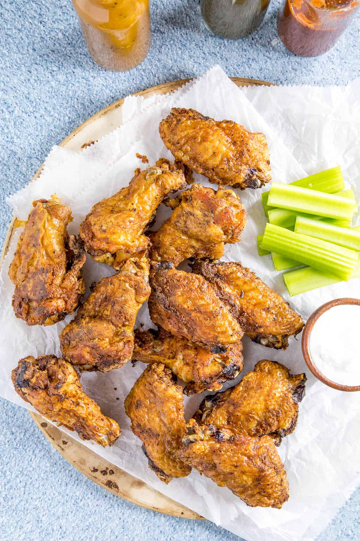 Crispy Baked Chicken Wings on a platter, served with hot sauce, celery and ranch dressing