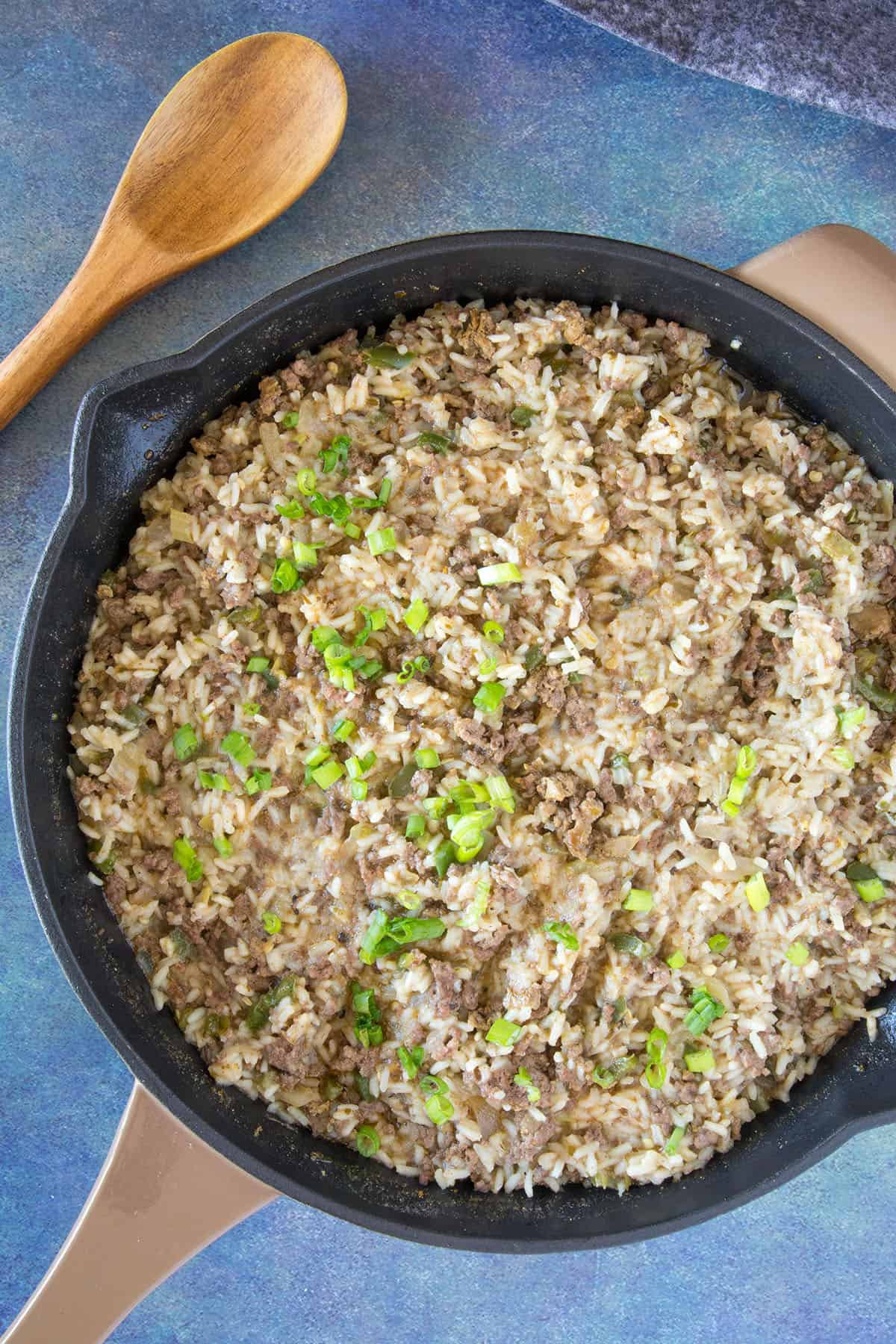 Dirty Rice in a pan, with garnish