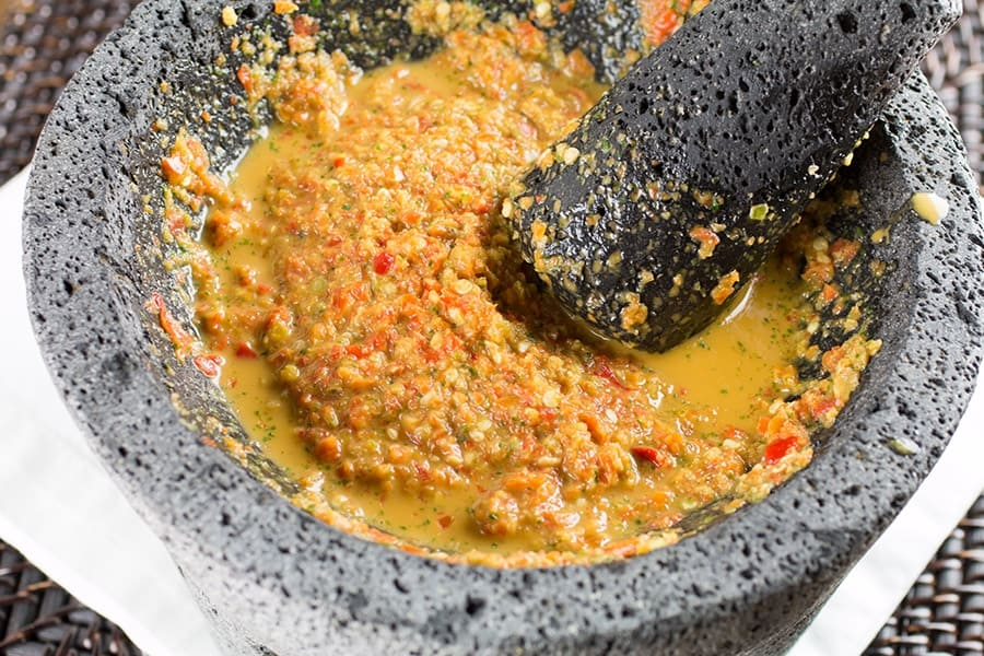 Habanero Chili Paste in a molcajete, being ground