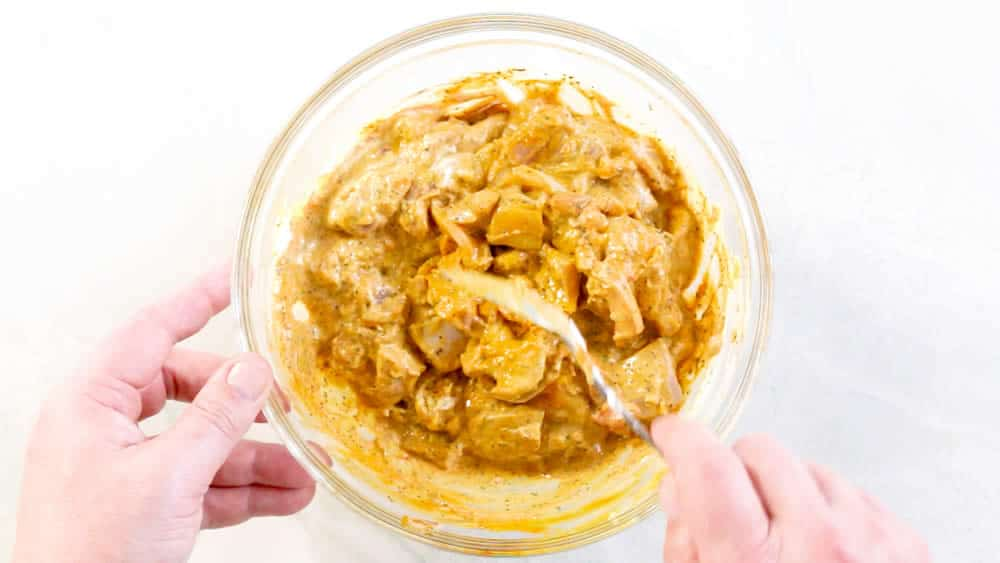 Stir the chicken with the thick butter chicken marinade