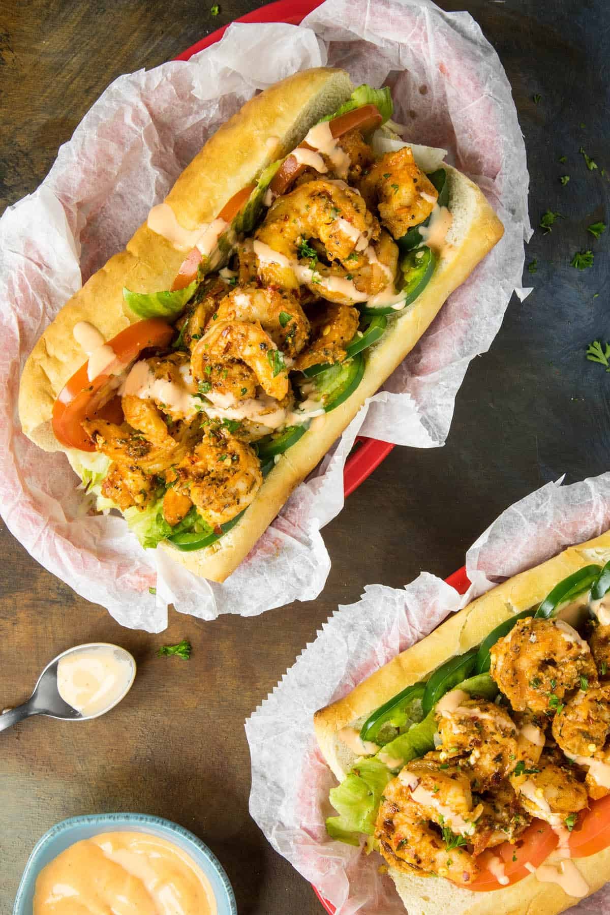 Grilled shrimp po boy sandwiches with extra Cajun sauce