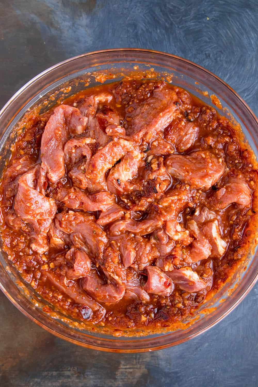 Marinating the pork to make tacos al pastor