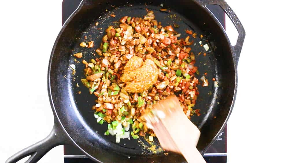 Stirring in the curry paste