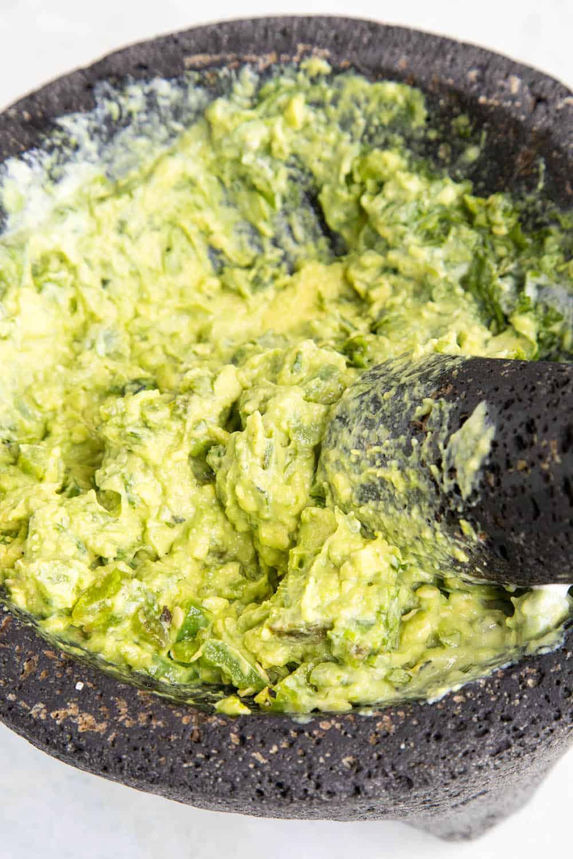 Making guacamole in my molcajete