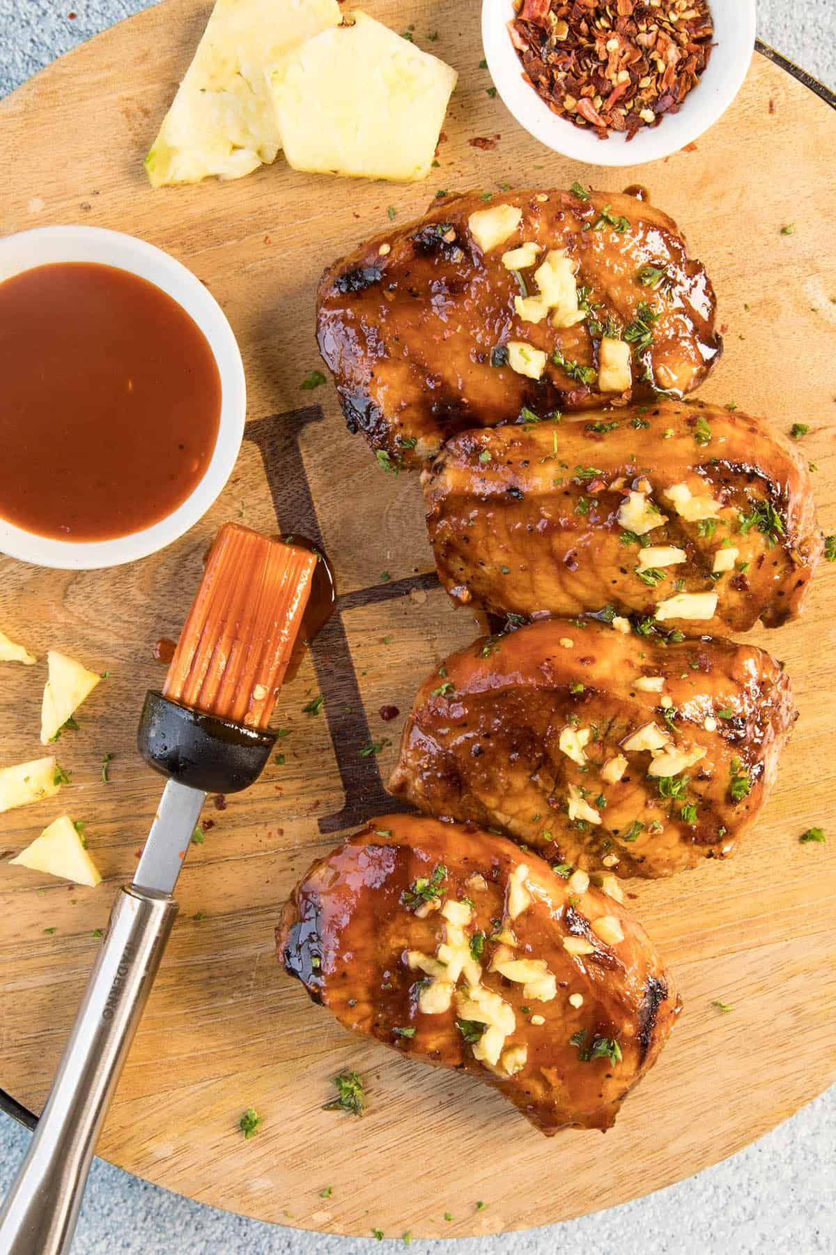 Grilled Pork Chops with Pineapple-Gochujang Glaze on a platter, ready to serve