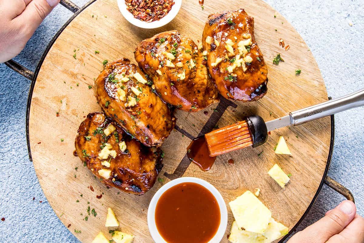 Serving up the Grilled Pork Chops with Pineapple-Gochujang Glaze