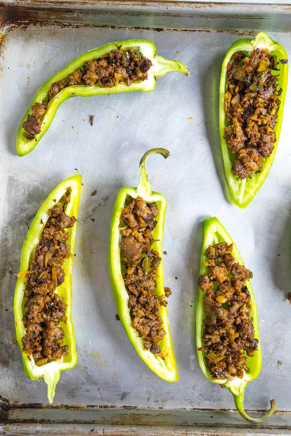Anaheim peppers stuffed with spicy cooked sausage