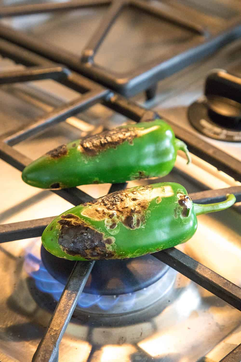 Roasting jalapeno peppers over an open flame