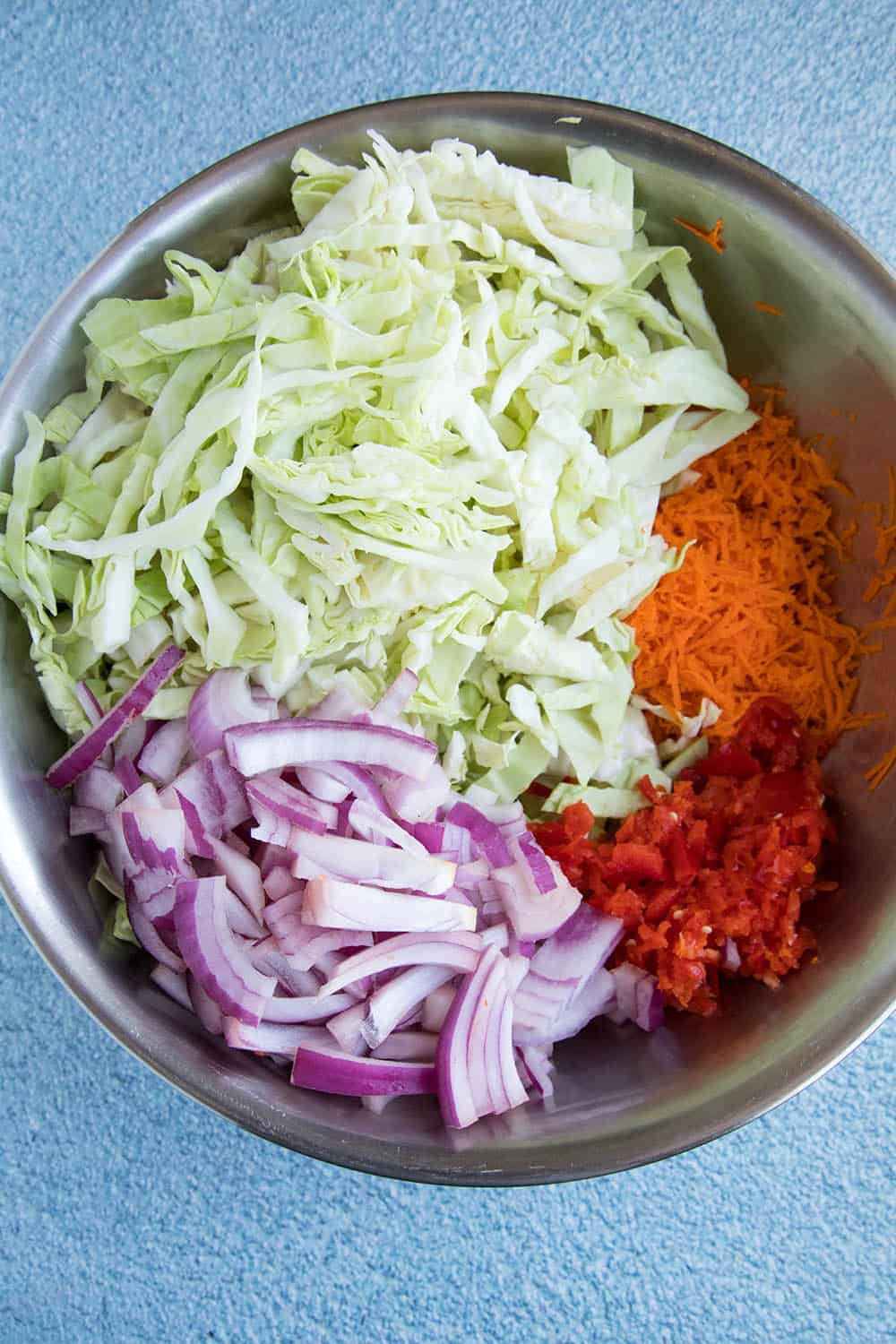 Shredded cabbage, onion, bell pepper and carrot