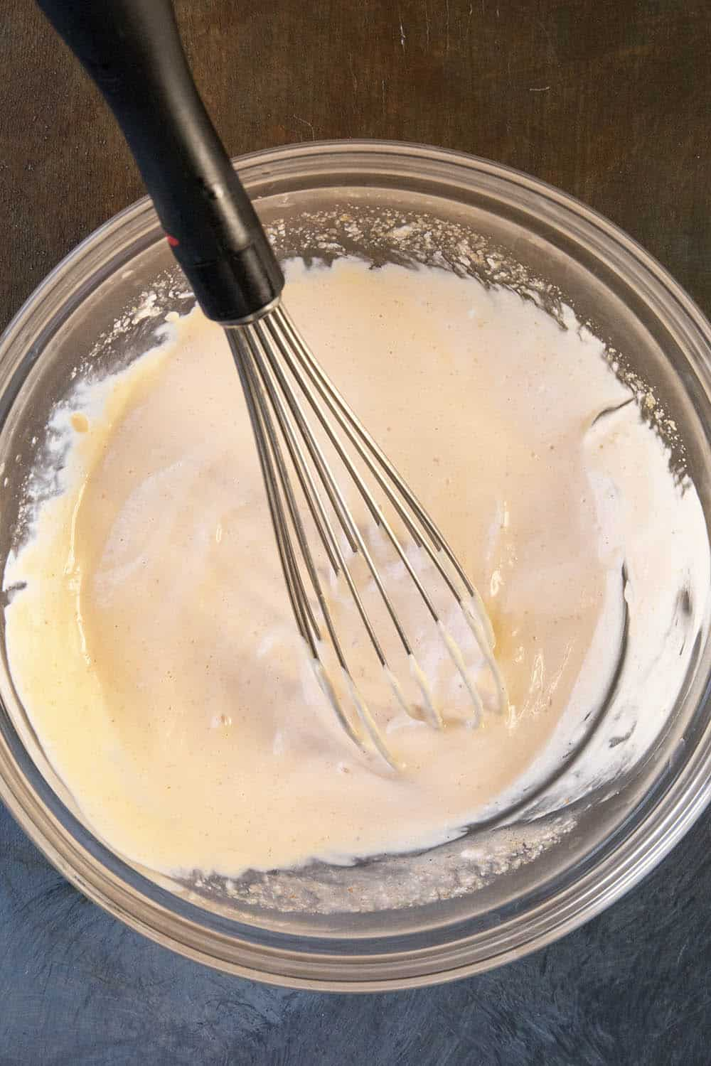 Whisking together the fish taco sauce recipe