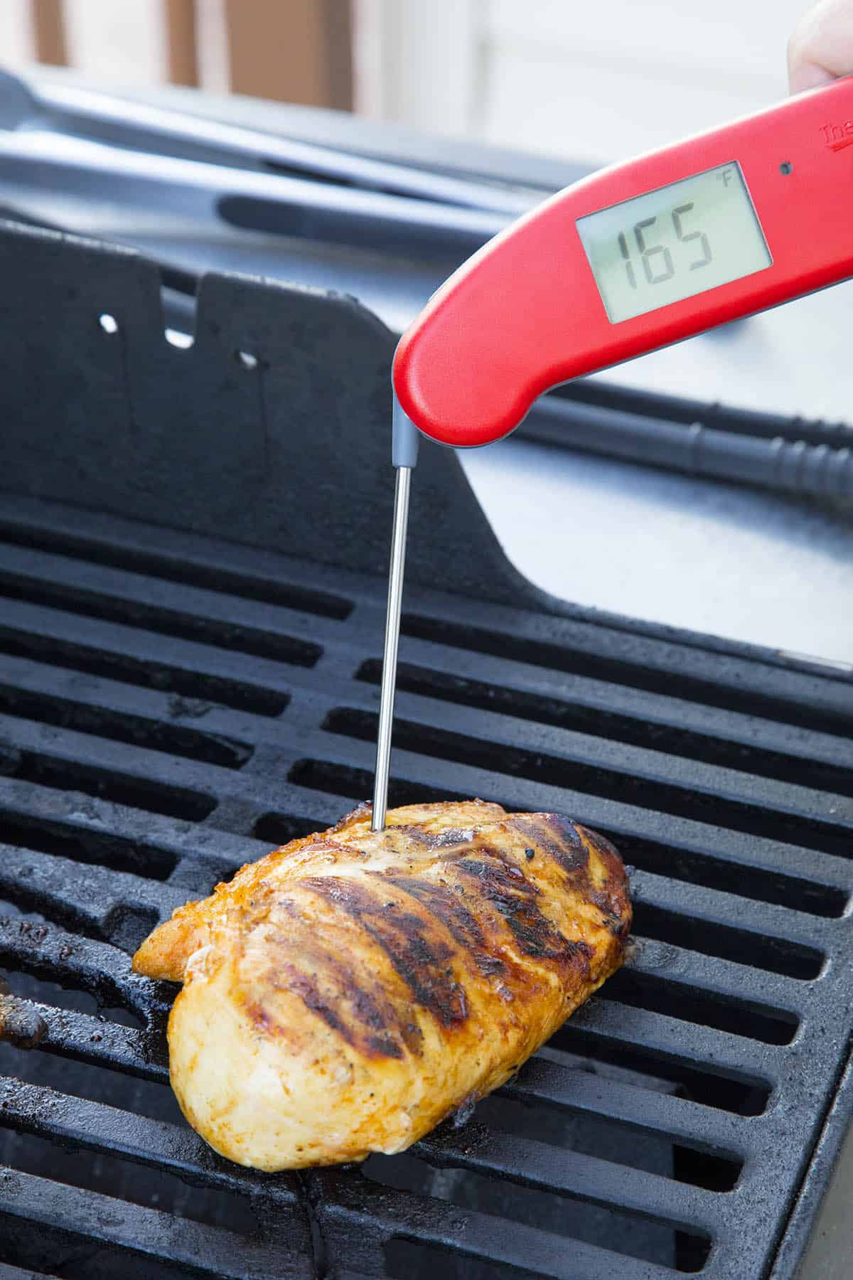 Testing the internal temperature of my grilled chicken
