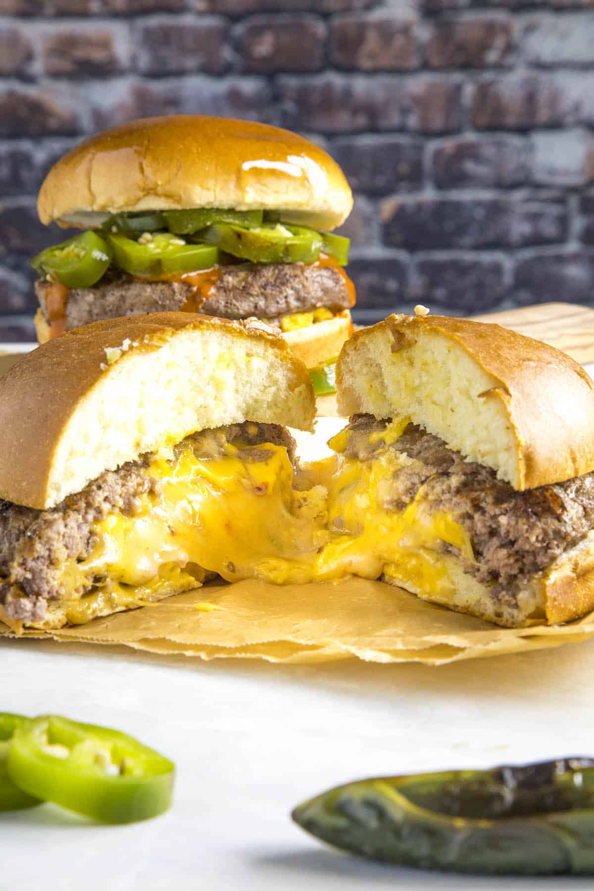 Juicy Lucy Burgers oozing melty cheese