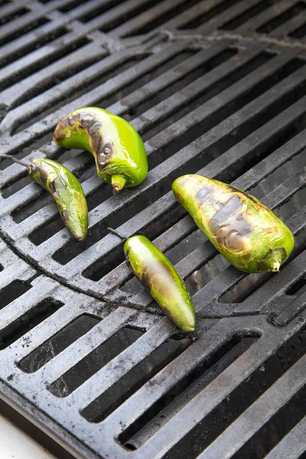 Roasting peppers to top our Juicy Lucy burgers