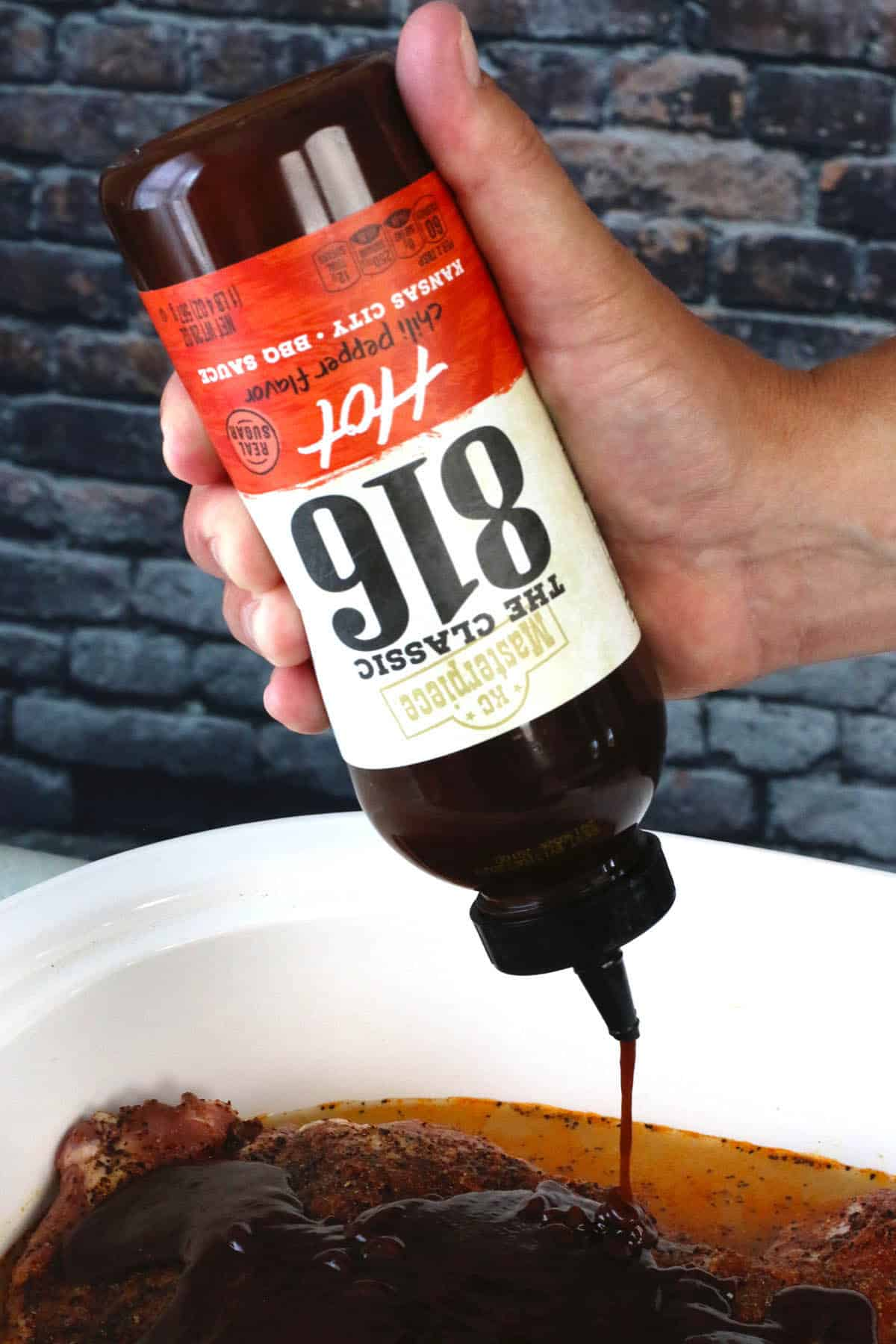 Pouring KC Masterpiece® 816 Hot BBQ Sauce