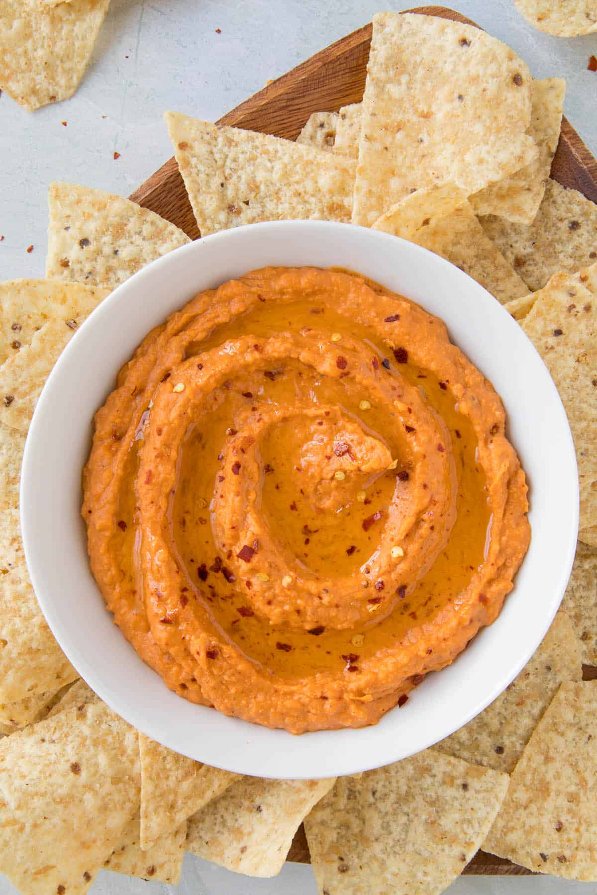 Creamy White Bean Dip with Harissa in a bowl with garnish