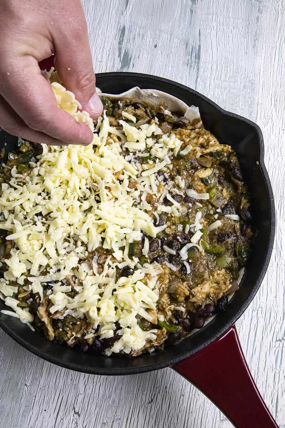 Top the casserole filling with shredded cheese