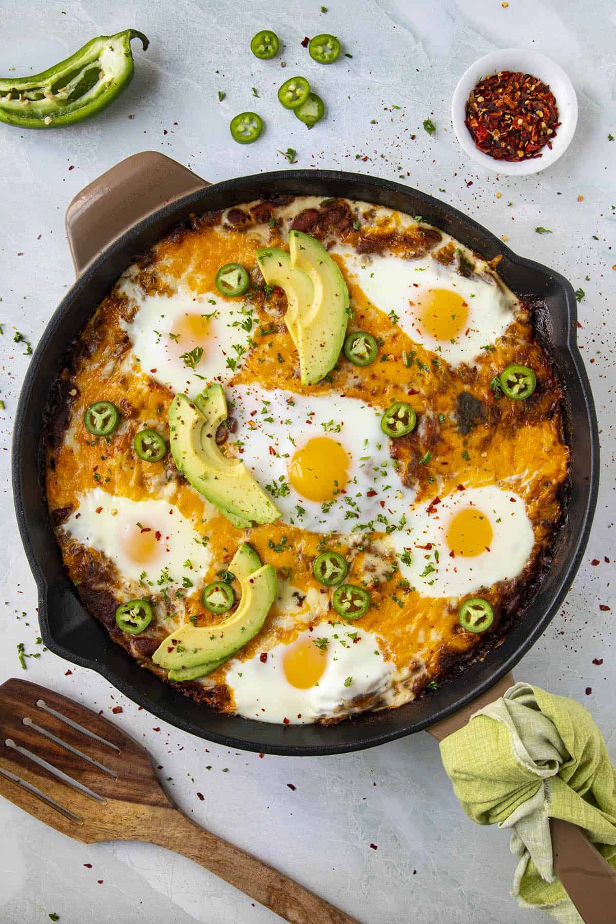 Huevos Ranchers Casserole in a pan, with eggs baked right in