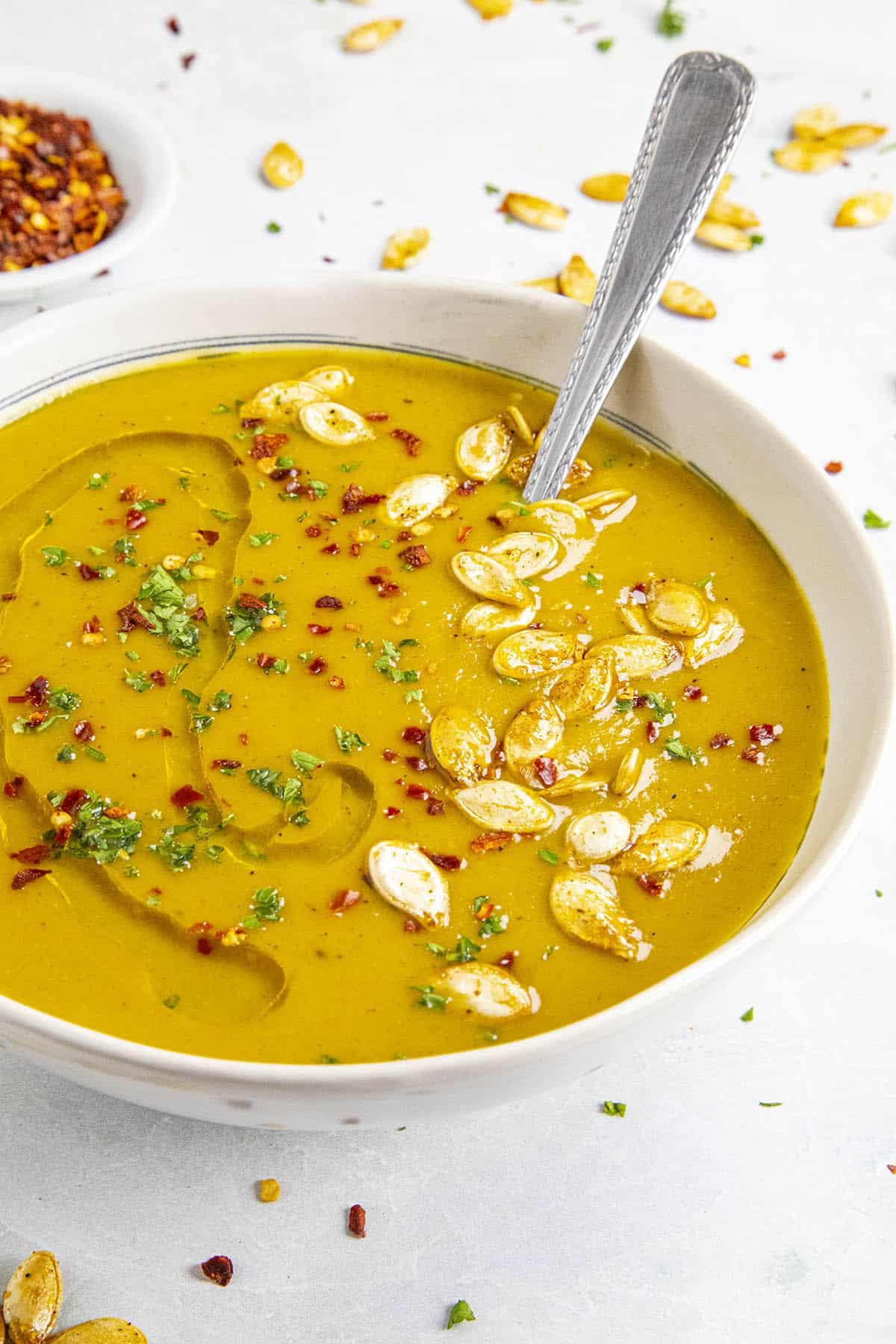 Spicy Pumpkin Soup in a bowl with pumpkin seeds for garnish