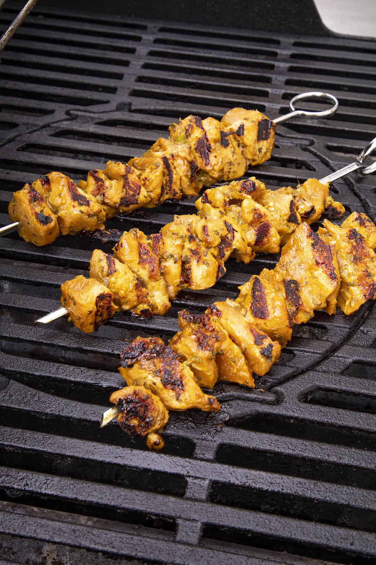 Chicken satay skewers on the grill